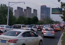 Cars choke the main approach to the latest Wanda Mall in China